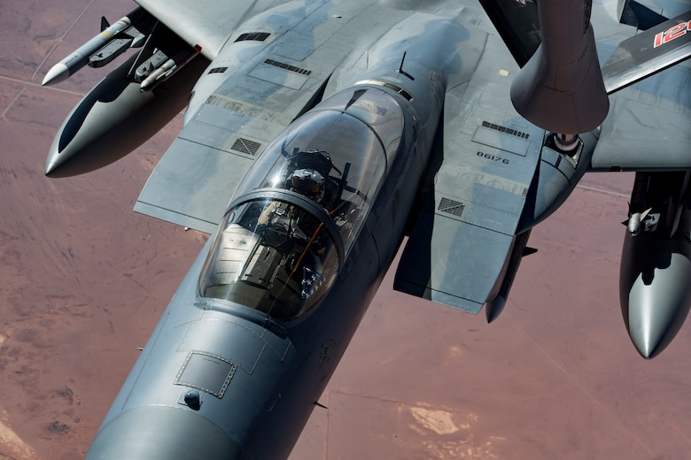 A U.S. Air Force F-15C Eagle is refueled by a KC-135 Stratotanker from the 28th Expeditionary Air Refueling Squadron while flying in support of Combined Joint Task Force – Operation Inherent Resolve Feb. 11, 2019. The tactical fighters add an additional layer of support to coalition forces on the ground. U.S. Air Forces Central Command Airmen, Joint personnel Coalition partners stand ready to defend our forces from any threat. (U.S. Air Force photo by Staff Sgt. Clayton Cupit)