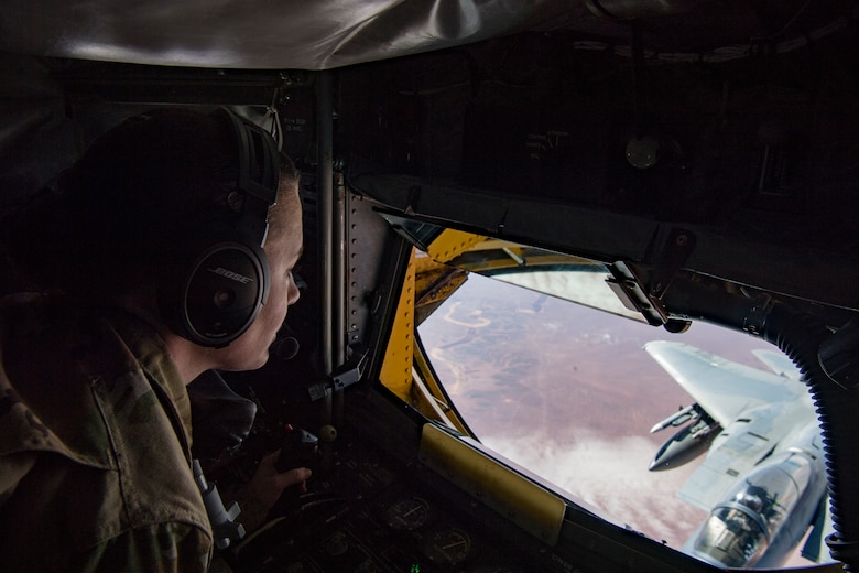 A U.S. Air Force boom operator with the 28th Expeditionary Air Refueling Squadron refuels an F-15C Eagle while flying in support of Combined Joint Task Force – Operation Inherent Resolve Feb. 11, 2019. The Eagles add an additional layer of support to coalition forces on the ground. U.S. Air Forces Central Command Airmen operate any time, any place and under any conditions in order to maintain air superiority and protect ground forces. (U.S. Air Force photo by Staff Sgt. Clayton Cupit)