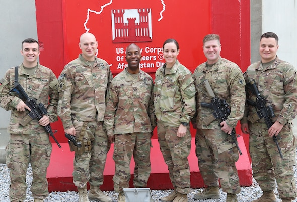 Members of the 264th Engineer Clearance Company join USACE Afghanistan District Commander, Col. Jason Kelly in front of the District Headquarters at Bagram.