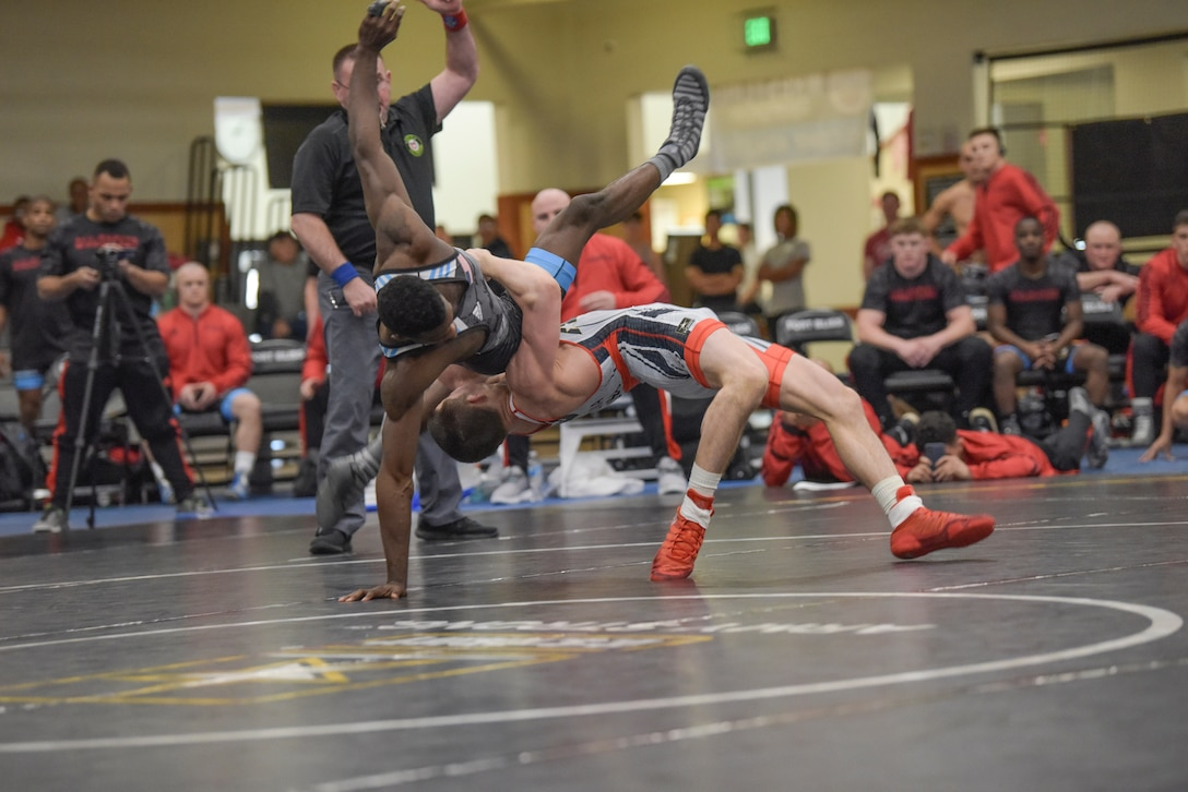 Hayden Tuma launches Xavier Johnson at 63 kg in the Army vs. Marines battle.  The 2019 Armed Forces Wrestling Championship held at the Soto Physical Fitness Center at Fort Bliss, Texas from 23-24 February featuring the top wrestlers in the United States from the Army, Marine Corps, Navy, Air Force and Coast Guard.  (U.S. Navy photo by Petty Officer 2nd Class J.E. Veal)