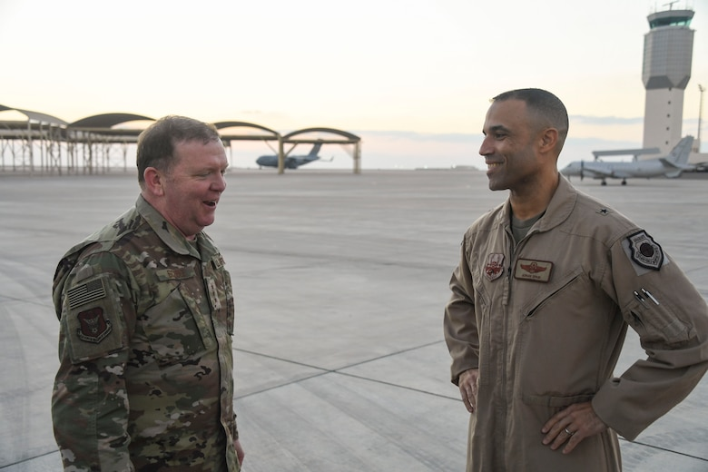 U.S. Air Force Lt. Gen. Richard Scobee, commander of Air Force Reserve Command, shares a story with Brig. Gen. Adrian Spain, 380th Air Expeditionary Wing commander, during his visit to Al Dhafra Air Base, United Arab Emirates, Feb. 13, 2019.