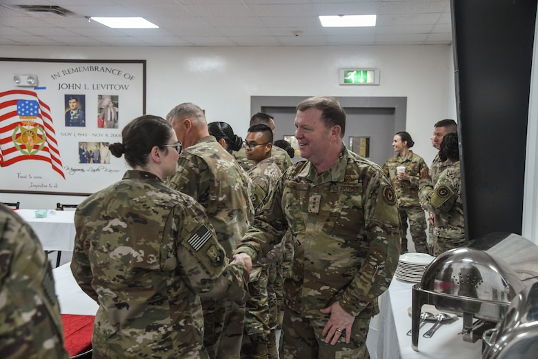 U.S. Air Force Lt. Gen. Richard Scobee, commander of Air Force Reserve Command, meets reservists during his visit to Al Dhafra Air Base, United Arab Emirates, Feb. 13, 2019.