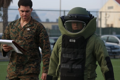 A U.S. Marine with Special Purpose Marine Air-Ground Task Force-Crisis Response-Africa 19.1, Marine Forces Europe and Africa, supervises a Marine conducting the Explosive Ordnance Disposal Lateral Move Screener on Naval Air Station Sigonella, Italy, Feb. 7, 2019.