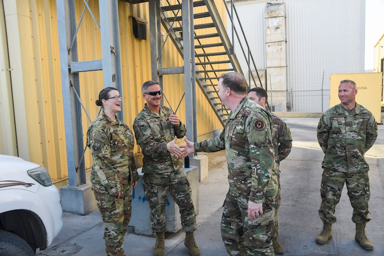 U.S. Air Force Lt. Gen. Richard Scobee, commander of Air Force Reserve Command, greets members of the 380th Expeditionary Operations Group during his visit to Al Dhafra Air Base, United Arab Emirates, Feb. 13, 2019.
