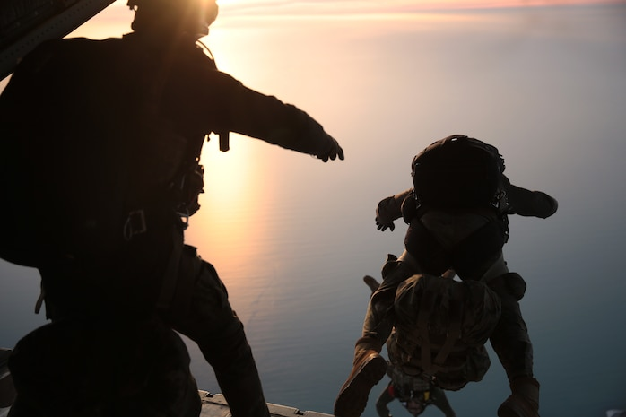 U.S. Marines with Special Purpose Marine Air-Ground Task Force-Crisis Response-Africa 19.1, Marine Forces Europe and Africa, along with members of the Spanish Army conduct a personnel air-drop operation in Rota, Spain, Feb. 6, 2019.