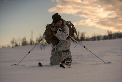 A U.S. Marine with Marine Rotational Force-Europe 19.1, Marine Forces Europe and Africa, attacks a simulated target during Exercise White Claymore in Blåtind, Norway, Feb. 17, 2019.