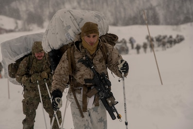 U.S. Marines with Marine Rotational Force-Europe 19.1, Marine Forces Europe and Africa, and British Royal Marines hike on skis during Exercise White Claymore in Blåtind, Norway, Feb. 14, 2019.