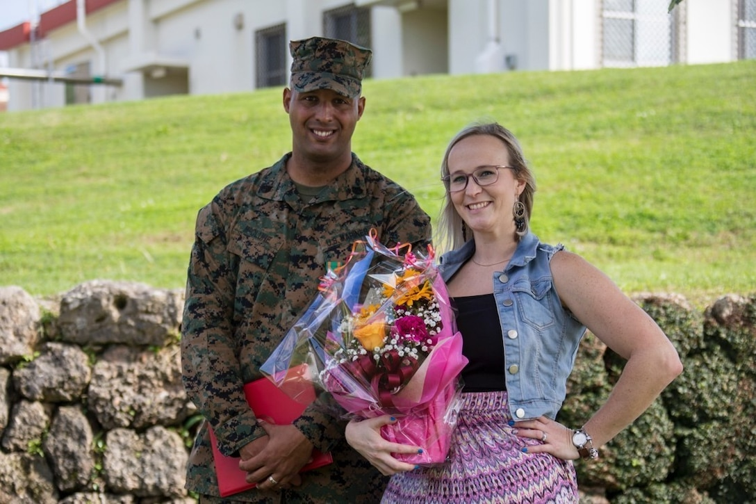 Staff Sgt. Jonathan McClure, left, and Jillian Romag, right, pose for a picture February 22, 2019, aT Camp Foster, Okinawa, Japan. McClure was awarded the Navy Achievement Medal for superior performance of duty while serving as a military policeman and accident investigation section chief Provost Marshal's office, H&S Bn, MCIPAC-MCB. With quick thinking and a bias for action, McClure rescued Romag from choking at a local restaurant.