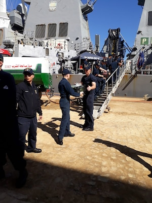avy logisticians with Combined Task Force 53 receive a delivery of fresh fruits and vegetables