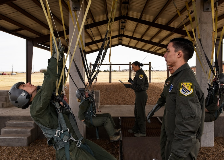 Pilot Training Next program students, left, simulate being in a parachute while 82nd Aerospace Medical Squadron physiology technicians supervise them at Sheppard Air Force Base, Texas, Jan. 29, 2019. This is the same training that the Euro-Nato Joint Jet Pilot Training program students with the 80th Flying Training Wing go through during their stay at Sheppard. (U.S. Air Force photo by Airman 1st Class Pedro Tenorio)