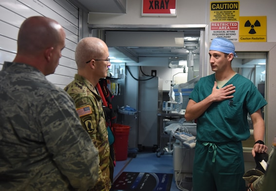 U.S. Air Force Maj. David Russo, 81st Medical Operations Squadron interventional cardiologist, discusses the mobile catheterization lab capabilities with U.S. Army Maj. Gen. Ronald Place, Defense Health Agency, director for the National Capital Region Medical Directorate and Transition Intermediate Management Organization, during an immersion tour inside the Keesler Medical Center at Keesler Air Force Base, Mississippi, Feb. 13, 2019. The purpose of Place's two-day visit was to become more familiar with the medical center's mission capabilities and to receive the status of the 81st Medical Group's transition under DHA. (U.S. Air Force photo by Kemberly Groue)
