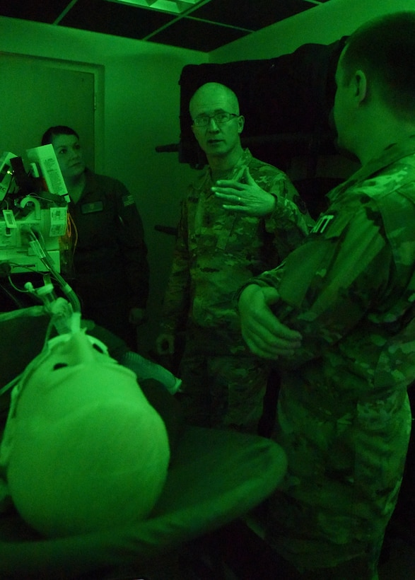 U.S. Army Maj. Gen. Ronald Place, Defense Health Agency, director for the National Capital Region Medical Directorate and Transition Intermediate Management Organization, discusses the benefits of the critical care air transport team simulation lab created to train for real world scenarios with U.S. Air Force Staff Sgt. Nicole Richards, 81st Medical Operations Squadron CCATT NCO in charge, and Capt. Thomas Ross, 81st Inpatient Operation Squadron officer in charge, during an immersion tour inside the Keesler Medical Center at Keesler Air Force Base, Mississippi, Feb. 13, 2019. The purpose of Place's two-day visit was to become more familiar with the medical center's mission capabilities and to receive the status of the 81st MDG's transition under DHA. (U.S. Air Force photo by Kemberly Groue)