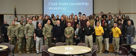 The 2019 Leadership Conference and Workshop group photo with Congressman Warren Davidson. There are soldiers in uniform and students gathers on a stage around the Congressman.
