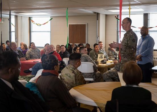 Col. Richard Gibbs, 377th Air Base Wing commander, speaks before the Black History Month Soul Food Tasting.