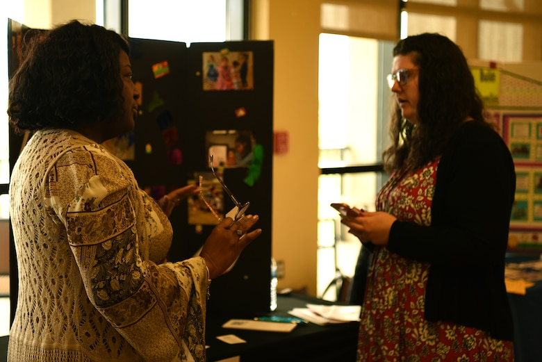 Anita Hymes, Community Child Care coordinator, speaks with Joy Brown, Airman and Family Readiness Center intern and base housing resident, during the Keesler Housing Review Open House inside the Bay Breeze Event Center at Keesler Air Force Base, Mississippi, Feb. 25, 2019. The open house gave military members and their families a chance to voice their housing concerns to leadership. (U.S. Air Force photo by Airman 1st Class Suzie Plotnikov)
