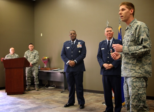 The 932nd Airlift Wing Director of Staff, Maj. Luke Barker, speaks about retiring Chaplain (Lt. Col.) William Thornton before a special gift presentation as part of the overall retirement ceremony held Feb. 9, 2019, at Scott Air Force Base, Illinois.  At center is former vice commander of the wing, Col. Esteban Ramirez, who was the guest speaker for the event.  Friends and family gathered from several states to wish Colonel Thornton well on his special day.  (U.S. Air Force photo by Lt. Col. Stan Paregien)
