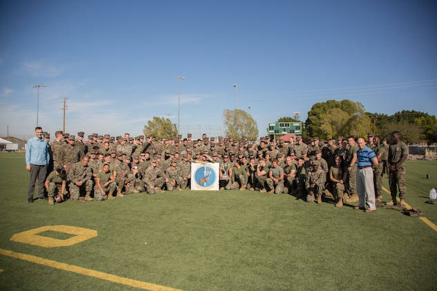 U.S. Marines stationed at Marine Corps Air Station (MCAS) Yuma, assigned to Marine Air Control Squadron (MACS) 1, pose for a photo after the 3rd Annual Super Squadron event at the MCAS Yuma Memorial Sports Complex January 11, 2019. The Super Squadron is a friendly competition between the various units on station, designed to help strengthen teamwork as well as boost station morale. MACS-1 won the competition for the 3rd year in a row, with Headquarters & Headquarters Squadron (H&HS) coming in second. (U.S. Marine Corps photo by Cpl. Sabrina Candiaflores)