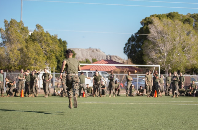 A U.S. Marine stationed at Marine Corps Air Station (MCAS) Yuma, sprints to his team after spinning his head on a bat as part of the Dizzy Izzy event during the 3rd Annual Super Squadron at the MCAS Yuma Memorial Sports Complex January 11, 2019. The Super Squadron is a friendly competition between the various units on station, designed to help strengthen teamwork as well as boost station morale. Marine Air Control Squadron (MACS) 1 won the competition for the 3rd year in a row, with Headquarters & Headquarters Squadron (H&HS) coming in second. (U.S. Marine Corps photo by Cpl. Sabrina Candiaflores)