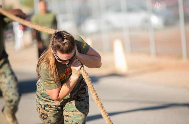 A U.S. Marine stationed at Marine Corps Air Station (MCAS) Yuma, pulls a HMMWV as part of the 3rd Annual Super Squadron at the MCAS Yuma Memorial Sports Complex January 11, 2019. The Super Squadron is a friendly competition between the various units on station, designed to help strengthen teamwork as well as boost station morale. Marine Air Control Squadron (MACS) 1 won the competition for the 3rd year in a row, with Headquarters & Headquarters Squadron (H&HS) coming in second. (U.S. Marine Corps photo by Cpl. Sabrina Candiaflores)