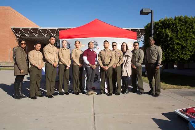 """U.S. Marines stationed at Marine Corps Air Station (MCAS) Yuma and personnel from MCAS Yuma interact with high school students and speak about the risks of drugs and alcohol at Cibola High School in Yuma, Ariz., Jan. 22, 2019. The Marines and personnel used games and """"beer goggles"""" to demonstrate the affects of alcohol and drugs. (U.S. Marine Corps photo by Cpl. Sabrina Candiaflores)"""