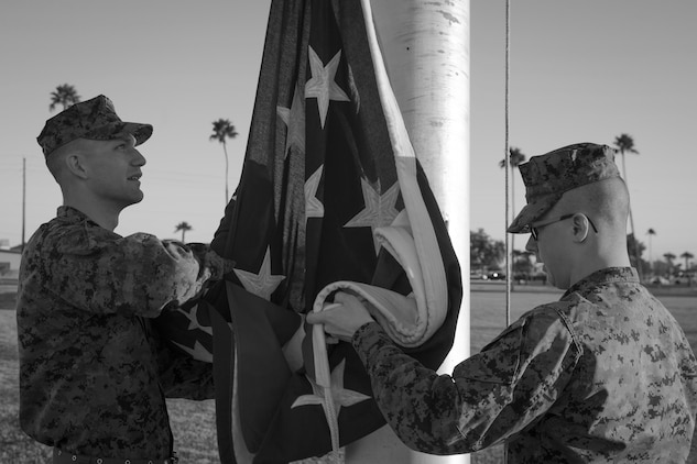U.S. Marines with Headquarters and Headquarters Squadron, Marine Corps Air Station (MCAS) Yuma, conduct morning colors at the Parade Deck on MCAS Yuma, Ariz., Jan. 25, 2019. Morning and evening colors refer to the raising and lowering of our national flag. Morning colors is the traditional flag raising ceremony which occurs every morning at 8:00 am. (U.S. Marine Corps photo by Sgt. Allison Lotz)