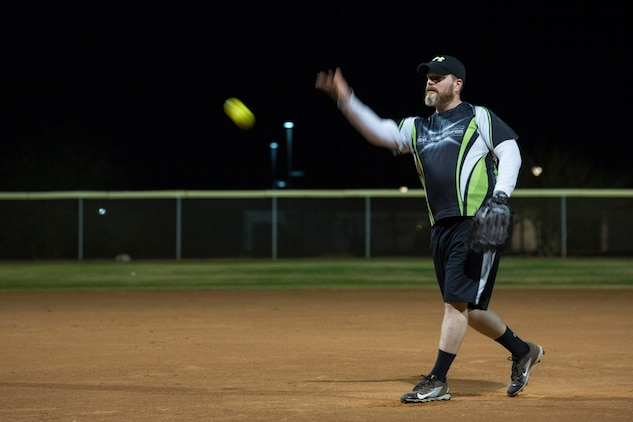 U.S. Marines, Sailors, and civilians with Marine Corps Air Station (MCAS) Yuma, participate in an intramural softball league on MCAS Yuma, Ariz., Jan. 24, 2019. The purpose of intramural sports is to provide opportunities for participation in a wide range of individual and team sports for both men and women regardless of skill level. (U.S. Marine Corps photo by Sgt. Allison Lotz)