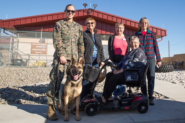 Guests participating in the Marine Corps Air Station (MCAS) Yuma Winter Tours pose for a group photo while viewing a demonstration of the obstacle course, the Marine Corps Martial Arts Program (MCMAP), Explosive Ordinance Detection (EOD), and a military working dog demonstration at various locations on MCAS Yuma, Ariz., Feb. 6, 2019. Col. David A. Suggs, the station commanding officer, resumed the tours in 2018 to strengthen the relationship with the outside community and give them the opportunity to see what the Marines aboard the air station do. (U.S. Marine Corps photo by Sgt. Allison Lotz)