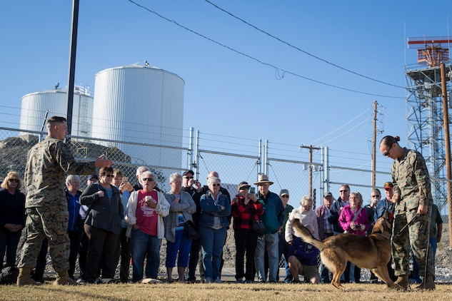 Guests participating in the Marine Corps Air Station (MCAS) Yuma Winter Tours observe a demonstration of the obstacle course, the Marine Corps Martial Arts Program (MCMAP), Explosive Ordinance Detection (EOD), and a military working dog demonstration at various locations on MCAS Yuma, Ariz., Feb. 6, 2019. Col. David A. Suggs, the station commanding officer, resumed the tours in 2018 to strengthen the relationship with the outside community and give them the opportunity to see what the Marines aboard the air station do. (U.S. Marine Corps photo by Sgt. Allison Lotz)