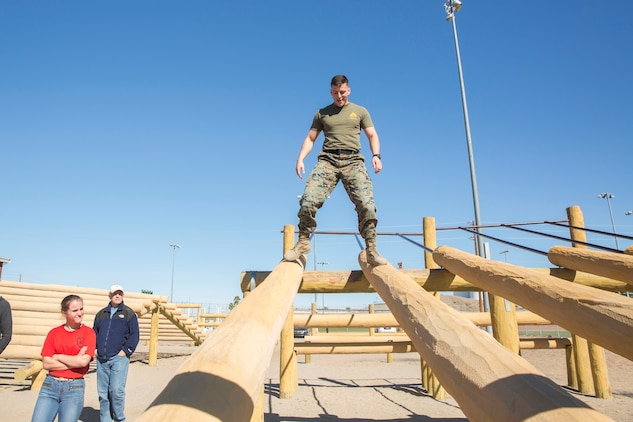 The Young Marines and Boy Scouts from Kingman, Ariz., visited Marine Corps Air Station (MCAS) Yuma Feb. 8, 2019. U.S. Marines stationed at MCAS Yuma demonstrated Explosive Ordnance Disposal (EOD) capabilities, Marine Corps Martial Arts Program (MCMAP) techniques, the Obstacle Course, and the Combat Fitness Test (CFT). The Young Marines and Boy Scouts also participated in some of these events. (U.S. Marine Corps photo by Cpl. Sabrina Candiaflores)