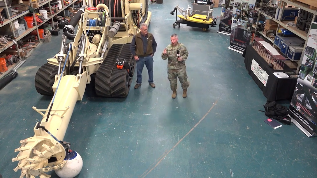Lt. Gen. Todd Semonite discusses a unique dredging capability with Thad Pratt at U.S. Army Engineer Research and Development Center's Coastal and Hydraulics Laboratory on Feb. 19, 2019.