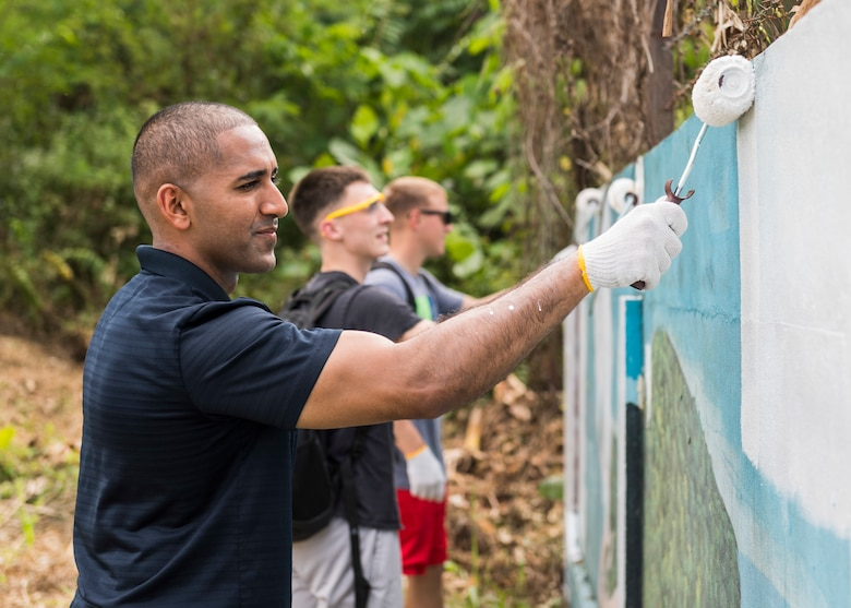 KOTA KINABALU, Malaysia (Feb. 25, 2019) – 1st Lt. Omer Rafiq, from Southbridge, Mass., with 31st Marine Expeditionary Unit (MEU) paints a section of a wall at the Sekolah Menengah Kebangsaan Inanam High School during a cultural exchange and community service event.