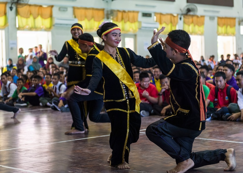 190225-N-WI365-1229 KOTA KINABALU, Malaysia (Feb. 25, 2019) – Students from the Sekolah Menengah Kebangsaan Inanam High School perform a traditional Malaysian dance during a cultural exchange and community service event.