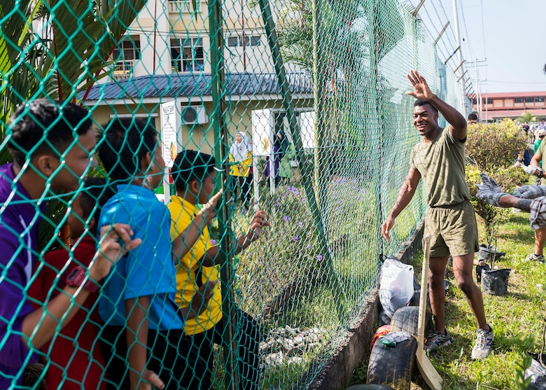 190225-N-WI365-1044 KOTA KINABALU, Malaysia (Feb. 25, 2019) – Lance Cpl. Daniel Notice, from Florissant, Miss., with the 31st Marine Expeditionary Unit (MEU) greets students from the Sekolah Menengah Kebangsaan Inanam High School during a cultural exchange and community service event.