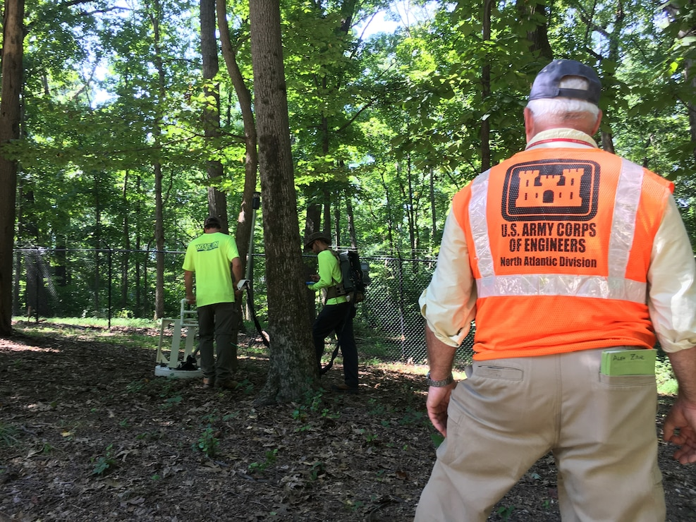 U.S. Army Corps of Engineers Project Manager Alex Zahl looks on as crews use a Manned Portable Vector to classify buried metallic anomalies during geophysical surveying efforts along Dalecarlia Parkway in the Spring Valley Formerly Used Defense Site September 6, 2018. The work is part of the Site-Wide Remedial Action approved for the FUDS. The surveying is part of an effort to identify metallic anomalies below the surface that could be munitions left in the ground as a result of military activity in the area during World War I. The MPV equipment helps determine whether buried metallic anomalies are munitions items that may potentially be hazardous or cultural debris that do not need to be removed.