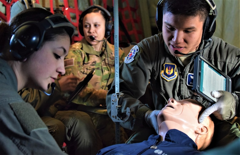 U.S. Air Force Senior Airman Dalila Allen, left, and Staff Sgt. Ryan Gomez, aeromedical evacuation technicians assigned to the 86th Aeromedical Evacuation Squadron, Ramstein Air Base, Germany, participate in an aeromedical readiness mission to Tallinn, Estonia, Feb. 23, 2019. The mission enabled training for semi-annual professional requirements and student upgrades, and simulated the challenges of logistics, alerting procedures, and storing and charging medical equipment at an unfamiliar location. (U.S. Air Force photo by 1st Lt. Andrew Layton)
