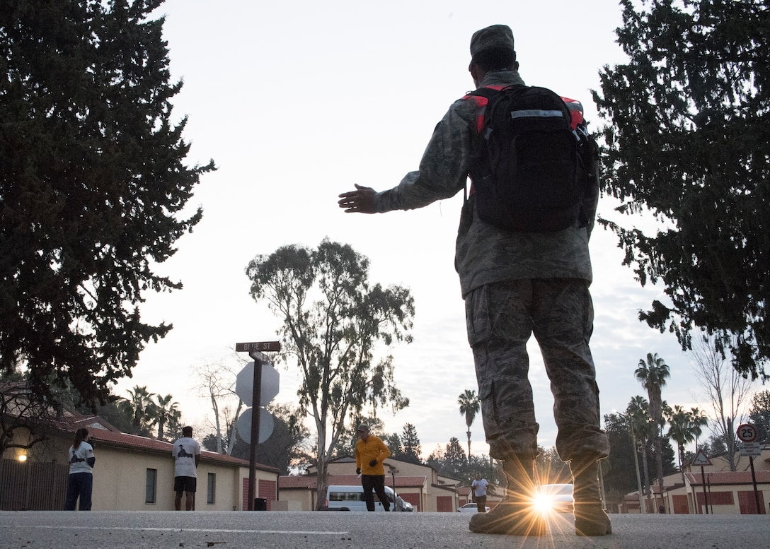 A volunteer directs runners during the Four Chaplains' Run Feb. 22, 2019, at Incirlik Air Base, Turkey.