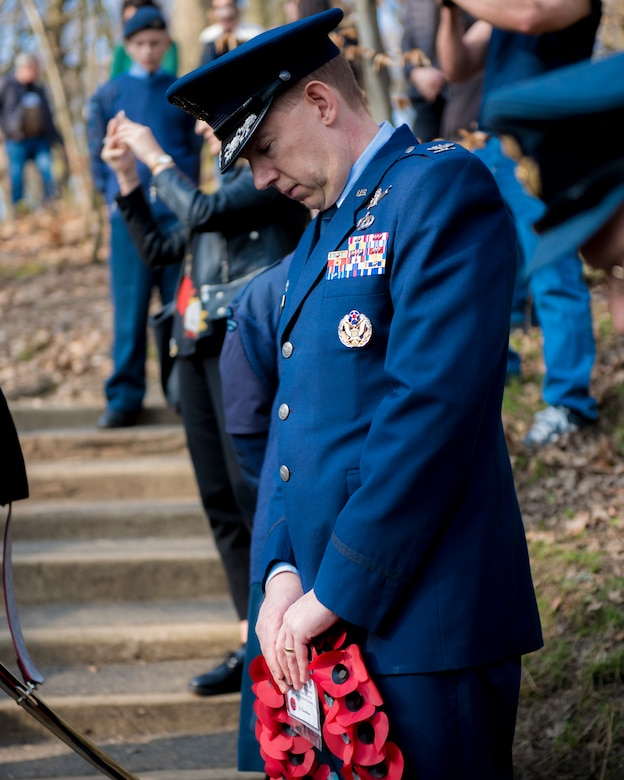 U.S. Air Force Colonel James Smith, RAF Menwith Hill Air Force Element Commander, prepares to lay a wreath in honor of the Mi Amigo crewmen at Sheffield, United Kingdom, February 24th, 2019. This year's annual memorial service was accompanied by a United States Air Force and Royal Air Force flypast in Endcliffe Park two days prior, where thousands of U.K. residents honored the memory of ten fallen U.S. Airmen who died when their war-crippled B-17 Flying Fortress crash landed to avoid killing residents and nearby children. (U.S. Air Force photo by Tech Sgt. Aaron Thomasson)