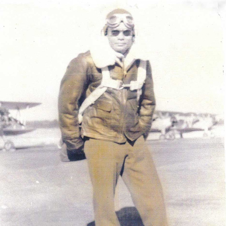 Franklin Macon stands for a photo in his flight suit
