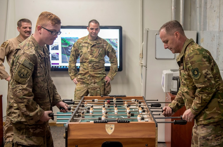 U.S. Air Force Maj. Gen. John M. Wood, Third Air Force commander and U.S. Air Force Senior Airman David Alley, 22nd Expeditionary Air Refueling Squadron weather forecaster, play foosball after an immersion briefing at Incirlik Air Base, Turkey, Feb. 22, 2019.