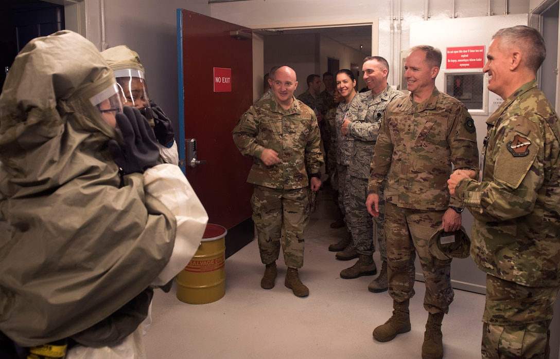Airmen from the 39th Medical Group demonstrate decontamination suits and procedures during a familiarization briefing with U.S. Air Force Maj. Gen. John M. Wood, Third Air Force commander, at Incirlik Air Base, Turkey, Feb. 22, 2019.