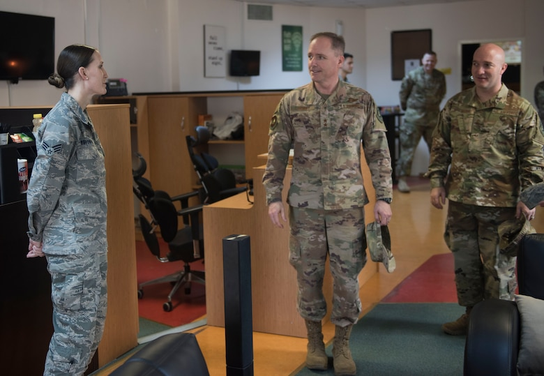 Senior Airman Kayla Hoffman, 728th Air Mobility Squadron commander's support staff, briefs U.S. Air Force Maj. Gen. John M. Wood, and U.S. Air Force Chief Master Sgt. Anthony Cruz Munoz, Third Air Force command chief, about the Titan's Refuge, at Incirlik Air Base, Turkey, Feb. 22, 2019.