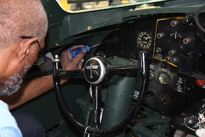 DAYTON, Ohio -- National Museum of the U.S. Air Force restoration specialist Dave Robb installs the pilot's instrument panel on the Boeing B-17F Memphis Belle on March 7, 2018. (U.S. Air Force photo by Ken LaRock)