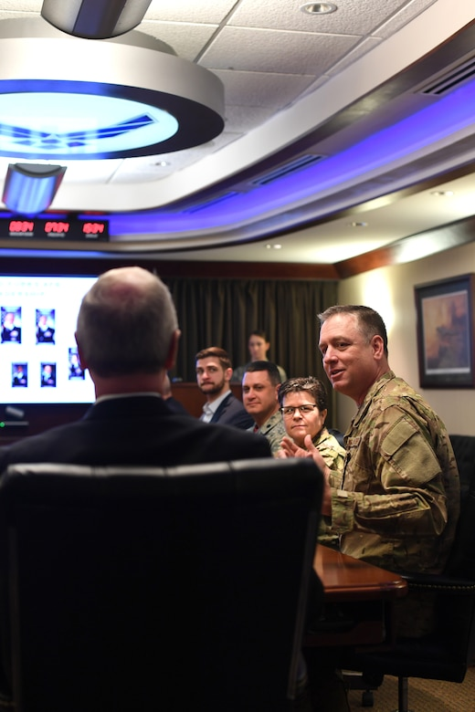Col. Benjamin Spencer, 319th Air Base Wing commander, provides a mission in-brief to Senator Kevin Cramer February 22, 2019, on Grand Forks Air Force Base, North Dakota. The brief included current data about the base and its priorities to improve squadron readiness, build leaders and bring the future with innovation. (U.S. Air Force photo by Senior Airman Elora J. Martinez)