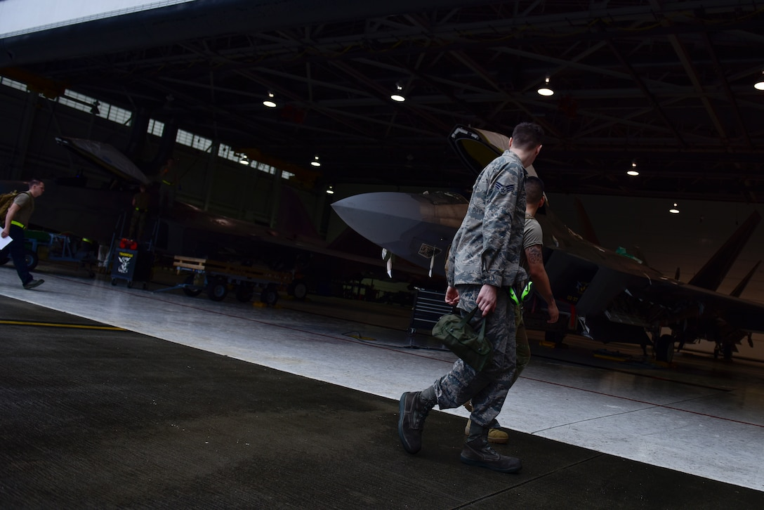 Airmen from the 325th Maintenance Squadron assigned to Tyndall Air Force Base, Fla., return to their maintenance operations section after completing routine maintenance on F-22 Raptors at Eglin AFB, Fla., Feb. 21, 2019. Several F-22's that were stationed at Tyndall AFB we evacuated to Eglin AFB hangars where its dedicated crews maintain them until Tyndall hangars are restored. (U.S. Air Force photo by Staff Sgt. Alexandre Montes)