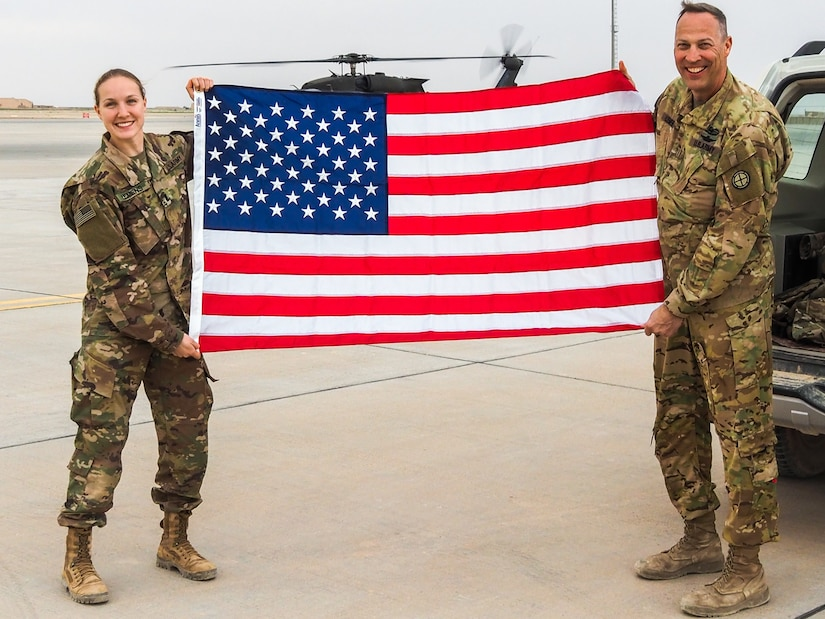 U.S. Army Chief Warrant Officer 5 Joseph Lemens, left, a helicopter maintenance test pilot assigned to the 935th Aviation Support Battalion, Missouri National Guard, and his daughter U.S. Army 1st. Lt. Jordan Lemens, right, a route clearance platoon leader assigned to 2nd platoon, B Co., 326th Brigade Engineer Battalion, pose together for a family photo at Al Asad Air Base, Iraq, Feb. 7, 2019.  Father and daughter, both simultaneously deployed to Iraq, were able to spend a few hours together despite working in different geographic areas.  The 935th ASB and 326th BEB support Combined Joint Task Force-Operation Inherent Resolve, working by, with, and through partner forces to defeat ISIS.