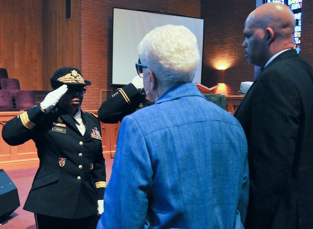Marla L. Andrews (center), daughter of U.S. Army Air Forces Capt. Lawrence E. Dickson, receives her father's medals from Brig. Gen. Twanda E. Young, deputy commanding general of the U.S. Army's Human Resources Command, during a Feb. 24 ceremony held at Fountain Baptist Church in Summit, New Jersey. Dickson was a Tuskegee Airman declared missing in action after his plane crashed in Europe in December 1944. Dickson's remains were identified in November 2018 using the latest DNA tests, making him the first to be identified out of more than two-dozen Tuskegee Airmen declared MIA during World War II.