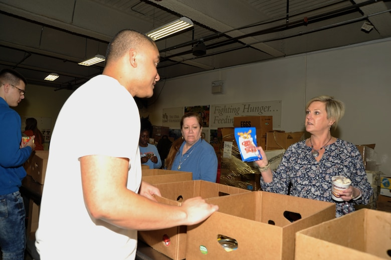 Tech. Sgt. Amosa Farani (married to 340th FTG force management NCO Tech. Sgt. Kassandra Farani) and Jeanne Goetze (married to 340th superintendent Chief Master Sgt. Scott Goetze) discuss the appropriate container for pet supplies during the 340th FTG's Feb. 22 community outreach event in support of the San Antonio Foodbank. Together, the 340th team and fellow volunteers sorted and packed more than 10,000 pounds of food and non-food items, including pet supplies. (U.S. Air Force photo by Debbie Gildea)