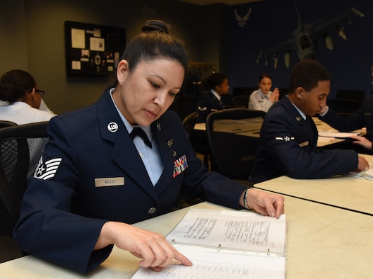 "U.S. Air Force Tech. Sgt. Barbara Kruse, 334th Training Squadron student, reviews aviation resource management apprentice course study material inside Wolfe Hall at Keesler Air Force Base, Mississippi, Feb. 26, 2019. Kruse graduated with perfect scores throughout the course. After graduation she will return to the 170th Operations Support Squadron as an aviation resource manager, Nebraska Air National Guard, at Offutt Air Force Base, Nebraska. ""There is a lot of information 1CO's are responsible for inputting and auditing, and the tiniest of errors has the potential to affect an aircrew member's professional records and career. This course did a great job at showing how attention to detail cannot be overemphasized."" (U.S. Air Force photo by Kemberly Groue)"