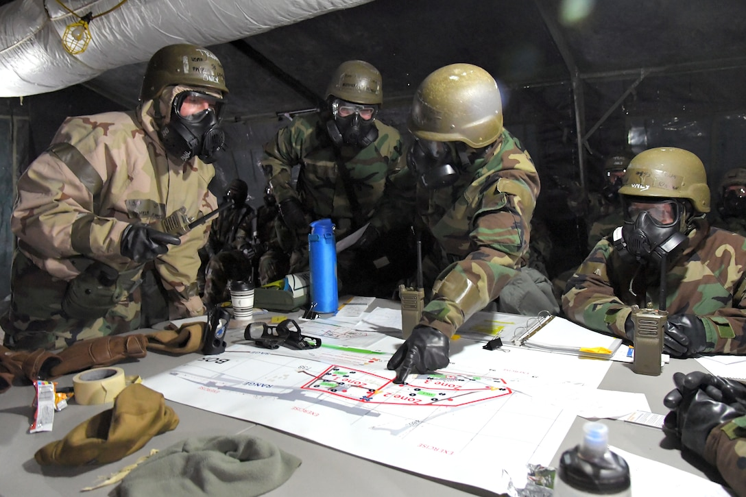 Airmen during a readiness exercise, Feb. 7, 2019, at Hill Air Force Base, Utah. During the exercise, Airmen donned mission-oriented projective posture, or MOPP, gear and were assessed on performing different tasks in a simulated toxic environment to improve their operational readiness. (U.S. Air Force photo by Todd Cromar)