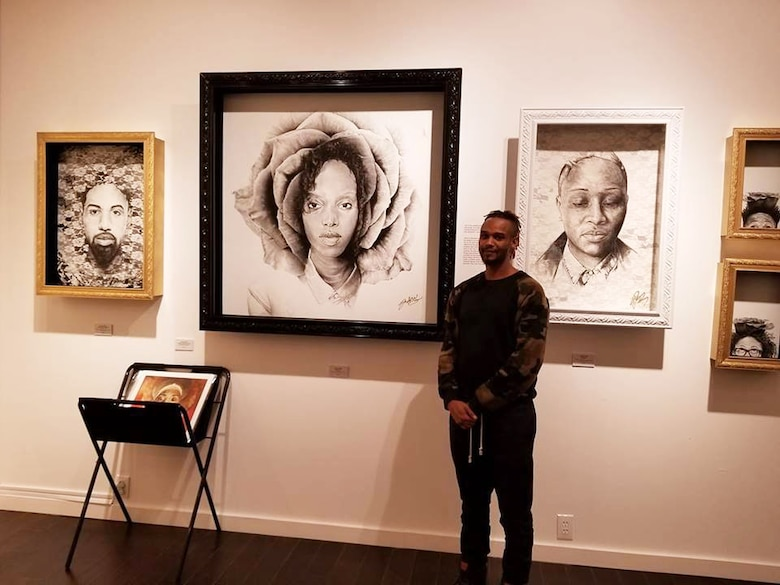 USACE Omaha District Visual Information Special Jeremy Bell stands in front of five of his original works at the Michael Birawer Gallery in Seattle Feb. 2018. (Courtesy photo)